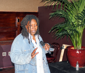 800px-Whoopi_Goldberg_stand_up_for_Rainforest_Action_Network